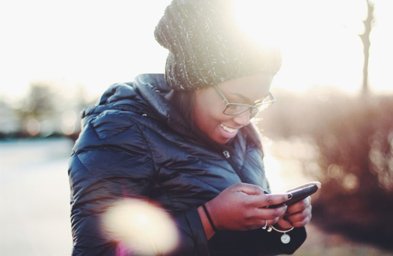 A smiling girl with a phone